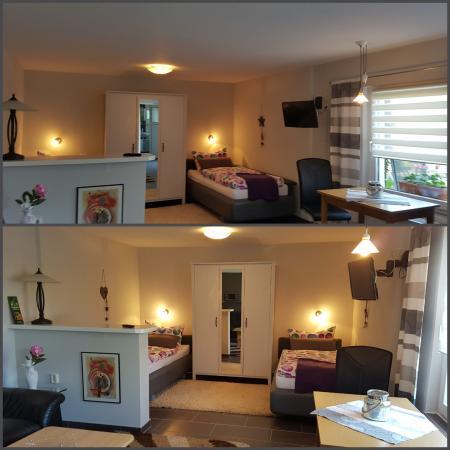 Wohn- und Schlafbereich mit zwei Betten und einer Schlafcouch