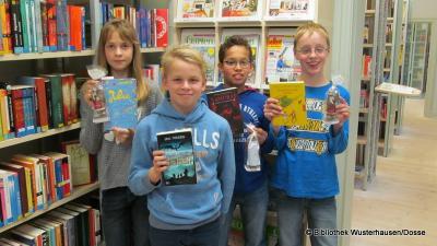 Foto zu Meldung: Vorlesewettbewerb der 6. Klassen in der Bibliothek Wusterhausen am 07.12.2015