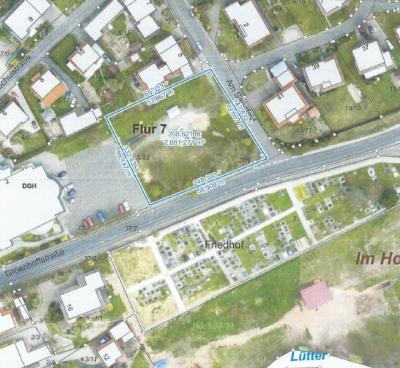 Die Luftaufnahme zeigt das quadratisch geschnittene Grundstück Groenhoffstraße/Ecke Am Sandfeld, auf dem die neue Kindertagesstätte gebaut werden soll.