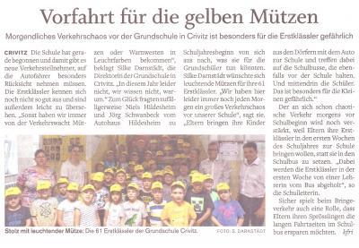 Foto zur Meldung: Gelbe Basecaps für unsere 1. Klassen vom Autohaus Hildesheim