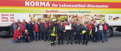 Foto zur Meldung: Rheinböller Feuerwehralterskameraden besichtigen Norma Logistik