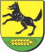 Blasonierung: In Gold über grünem Schildfuß ein aufgerichteter schwarzer Wolf mit rot ausgeschlagener Zunge; im grünen Schildfuß eine liegende, goldene Ähre mit fünf Grannen.