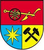 Blasonierung: Schild geteilt und halbgespalten, oben in Rot ein goldener Pflug, unten in Blau ein achtstrahliger goldener Stern, unten links ein schwarzes Bergmannsgezähe