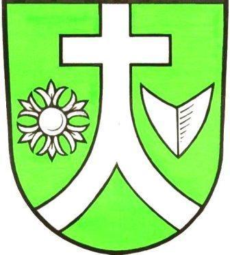Blasonierung: In Grün ein silbernes Hochkreuz mit einem eingebogenen gesparrten Fuß, begleitet rechts von einer sechsblättrigen silbernen Kornblume, links von einer gestürzten silbernen Pflugschar.