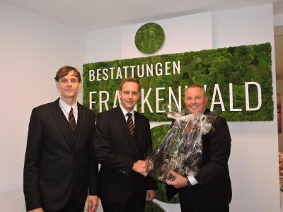Bild von links: René Franz, Lucien Pinske und Erster Bürgermeister Stefan Busch