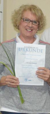 Foto zur Meldung: Familienpaten erhalten Ehrung für zehn Jahre Engagement
