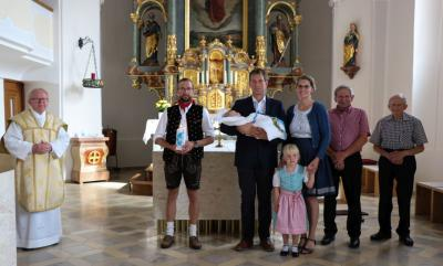 Foto zur Meldung: Taufe als Aufnahme in die Kirchengemeinde gefeiert