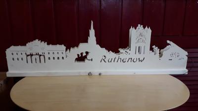 Foto zur Meldung: Beleuchtete Schwibbögen Skyline Rathenow