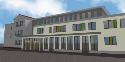 Blick vom Schulhof auf den Neubau und den Altbau im Hintergrund