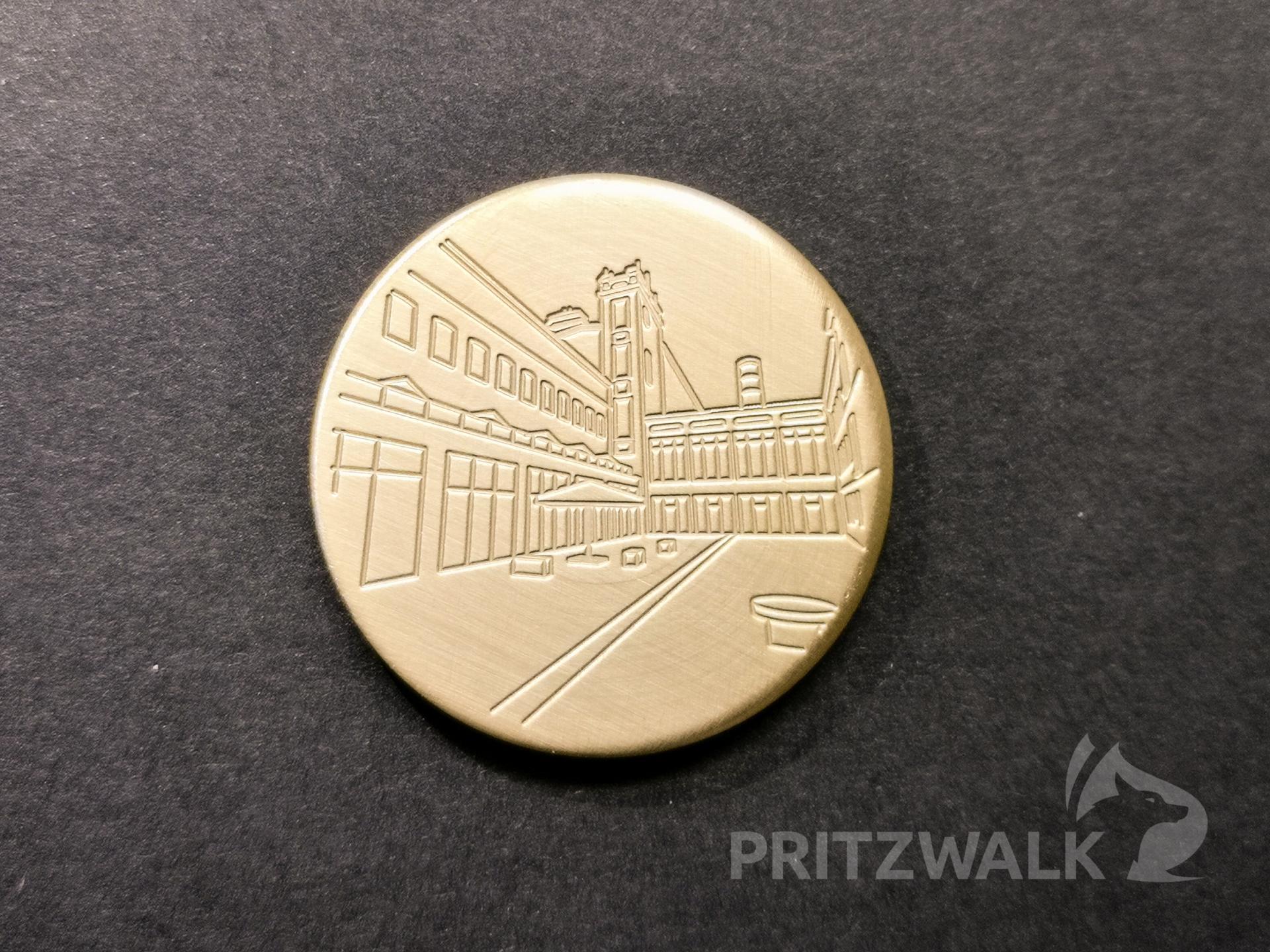 Januar-Münze mit Tuchfabrik.