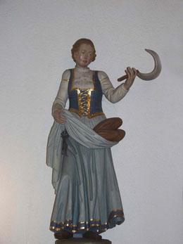 Die heilige Notburga mit Sichel und Brot