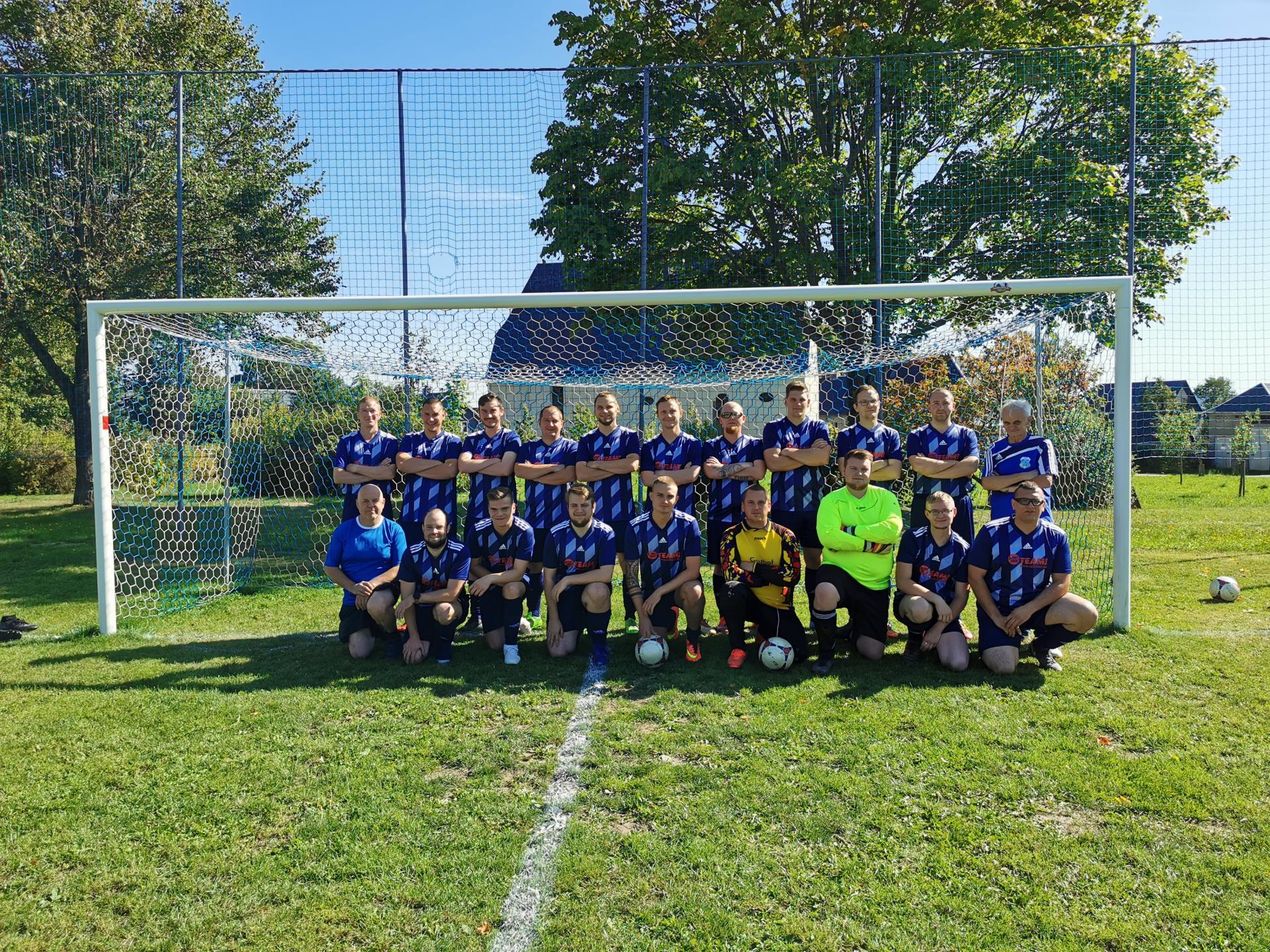 Fußballmannschaft im Tor