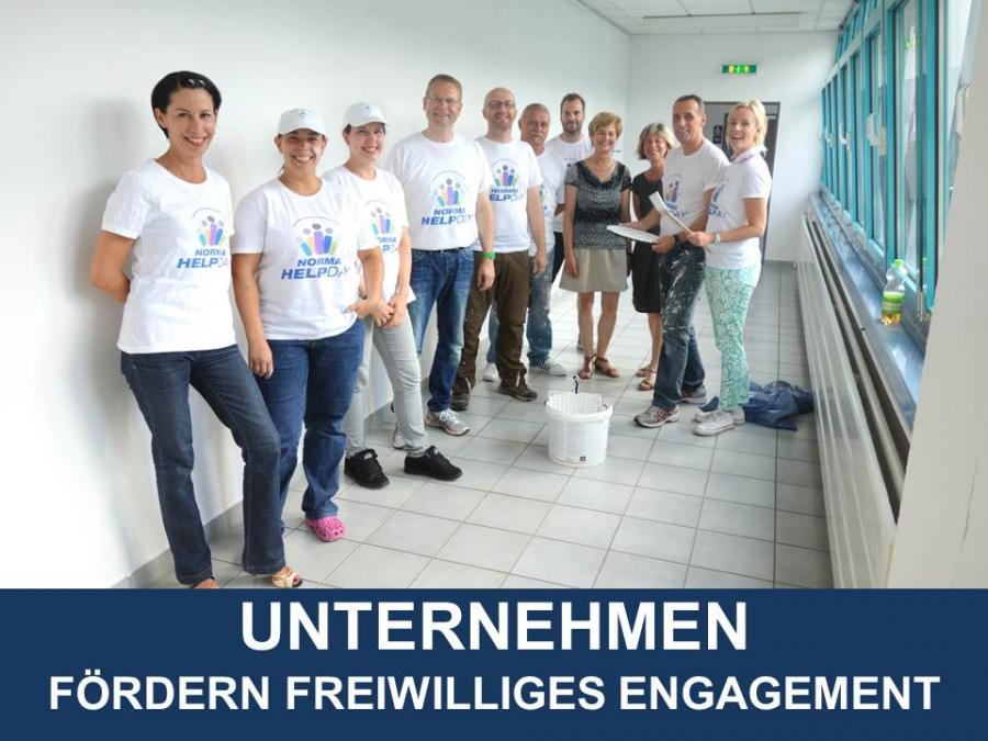 Link zu Unternehmen fördern freiwilliges Engagement; Bild zeigt einige Beschäftigte eines Unternehmens